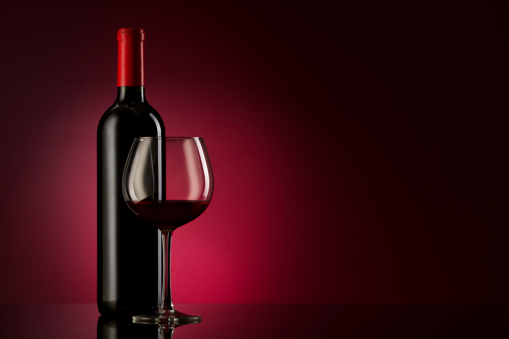 bottle with red wine and glass on a red gradient bottle red wine